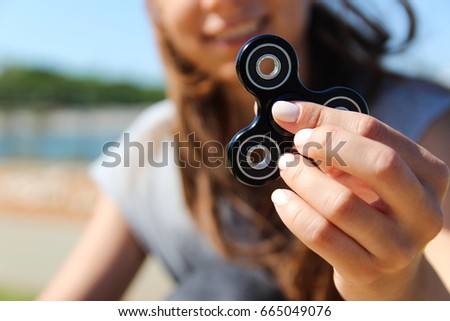 Women and men hold a white and black spinner  #665049076