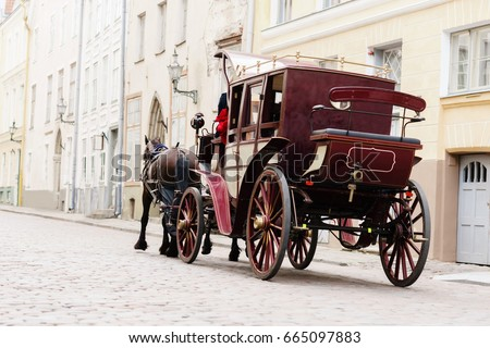 Beautiful old couch in old town. Traveling, romance, love concept. Royalty-Free Stock Photo #665097883