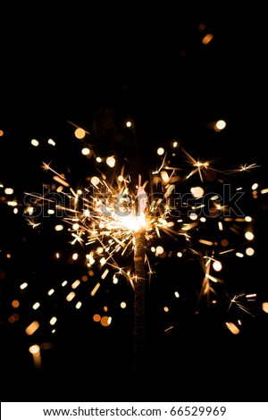 yellow sparkler with fire particles #66529969