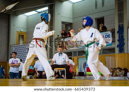 BERLIN - MARCH 18, 2017:Girl-fighters on tatami. European championship Kyokushin World Union (KWU) for Children and Youth. #665439373
