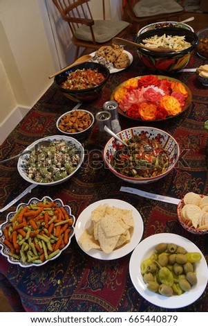 Turkish meze appetizers and salads on serving table in Seattle #665440879