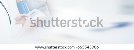 Doctor measuring patient blood pressure at clinic #665545906