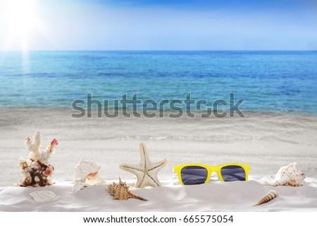 Holiday summer, sunglasses, Starfish, seashells,  on seashore - landscape beach background  #665575054