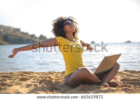 Successful girl working at the beach and relaxing #665619871