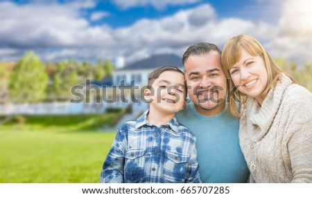 Mixed Race Family In Front Yard of Beautiful House and Property. #665707285