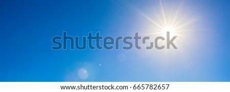 Blue sky with bright sun #665782657