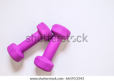 Purple dumbbells, fitness concept isolated on white background, fitness concept isolated on white background, sport, body building.Concept healthy lifestyle, sport and diet. Sport equipment.Copy space #665913343