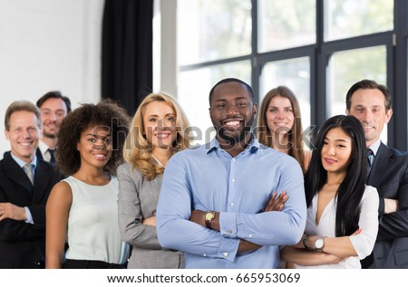 African American Businessman Boss With Group Of Business People In Creative Office, Successful Mix Race Man Leading Businesspeople Team Stand Folded Hands, Professional Staff Happy Smiling Royalty-Free Stock Photo #665953069