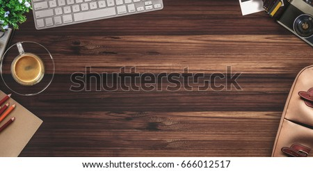 Rustic wood designer desk table with photographer stuff. Top view with copy space, flat lay or hero header concept.