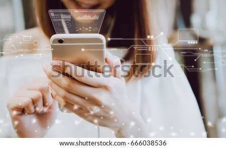 Women using a smartphone in the display and technology advances in stores. Take your screen to put on advertising. Royalty-Free Stock Photo #666038536