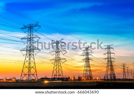 high voltage post,High voltage tower sky sunset background #666043690