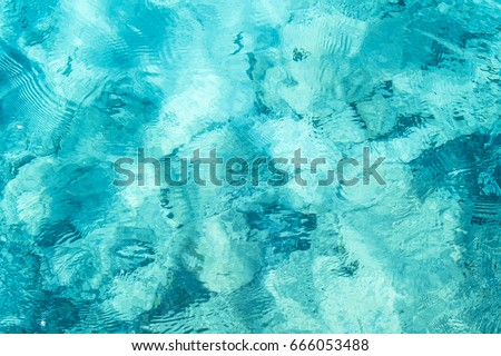 Transparent turquoise sea water, natural background. Emerald Coast, Sardinia, Italt. Royalty-Free Stock Photo #666053488