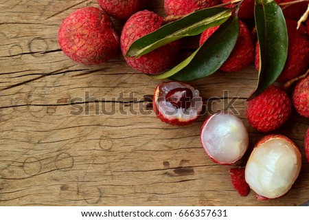 litchi, lichee, lychee, or lichi, Litchi chinensis on old rustic wood background with copy space #666357631