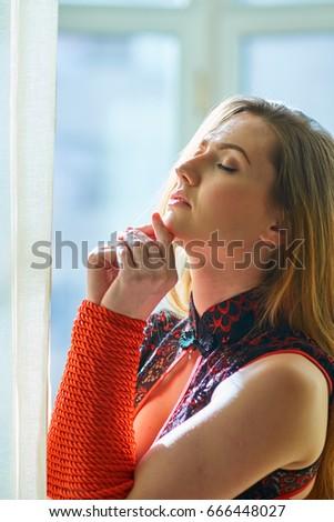 Beautiful young woman posing in lingerie #666448027