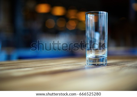 Empty glass on the dark wooden table in cafe. close up. #666525280