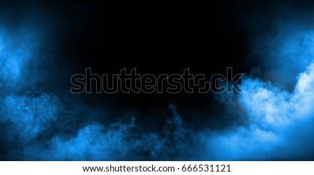 Dark background full of dense, white smoke Royalty-Free Stock Photo #666531121