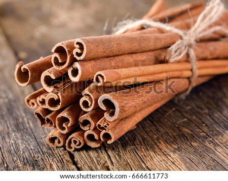 Cinnamon on table wooden background. #666611773
