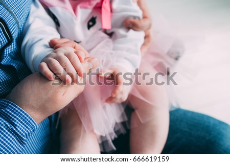 Baby's hand holds dad's hand, Daughter holds father's hand, Baby holds daddy's hand #666619159