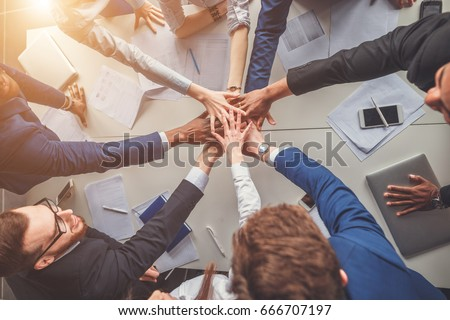 success and winning concept - happy business team celebrating victory in office Royalty-Free Stock Photo #666707197