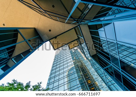 View from the bottom at high risers buildings.Abstract fragment of the architecture of modern luxury hotel, shopping mall, business center. #666711697