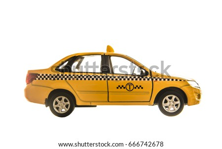 toy - yellow taxi car model. isolated on white background. yellow taxi car. idea, symbol, concept of urban service #666742678