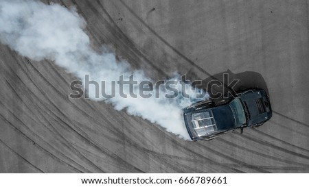Top view aerial photo from flying drone of a professional driver drifting car on asphalt track. #666789661