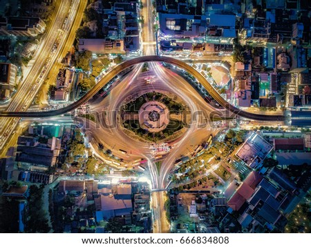 Beautiful Roundabout Victory Monument Aerial Top view Thailand with long exposure cars traffic #666834808