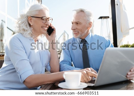 Smiling woman pointing on the laptop #666903511