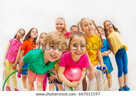 Sporty kids and gymnastics coach having fun in gym Royalty-Free Stock Photo #667015597