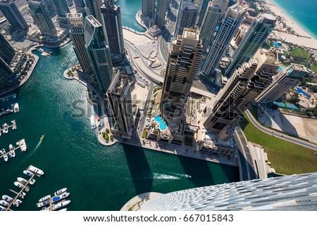 Dubai skyscrapers from above. Incredible Dubai view. Futuristic skyline. Dubai Marina aerial view. Skyscraper view.