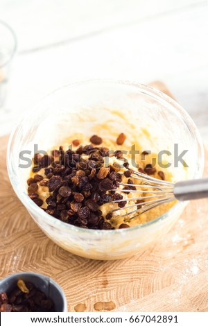 MIxing baking ingredients in a bowl for cake or pancakes. Light food photography concept #667042891