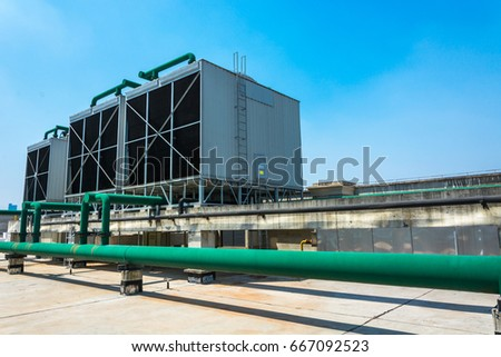 Sets of cooling towers in data center building. #667092523