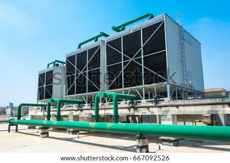 Sets of cooling towers in data center building. #667092526