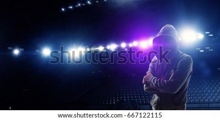 Silhouette of man in hoody #667122115