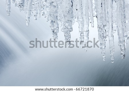 Winter cascade framed by icicles, Orangeville Creek, Michigan, USA Royalty-Free Stock Photo #66721870