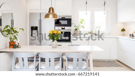 front view banner of a kitchen table in a fancy bright kitchen Royalty-Free Stock Photo #667219141
