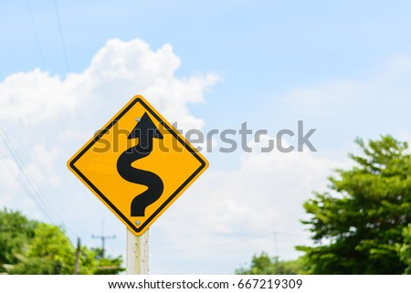 Road sign. Traffic sign. twisty road.