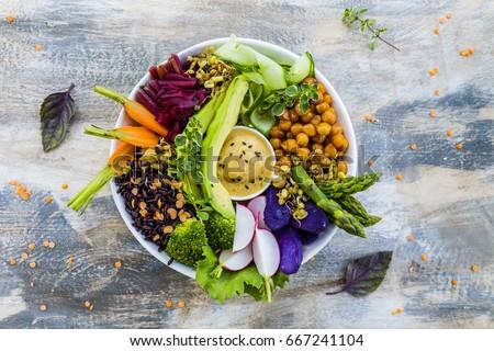 Buddha bowl, healthy and balanced food.  Royalty-Free Stock Photo #667241104