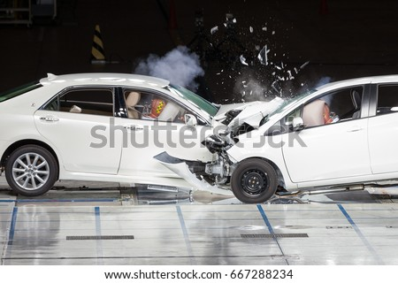 Front End Collision during a Crash Test. Royalty-Free Stock Photo #667288234