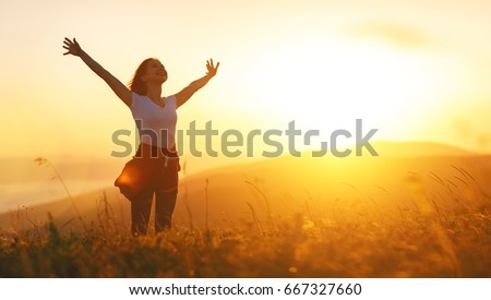 Happy woman   on the sunset in nature in summer with open hands Royalty-Free Stock Photo #667327660