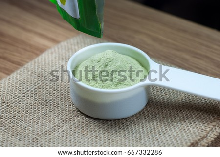 Green tea powder in white cup #667332286