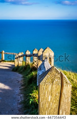 Focus Selection of Wooden Fence with Deep Blue Sea Background #667356643