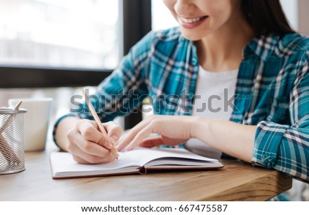 Elegant smart woman writing down her ideas #667475587