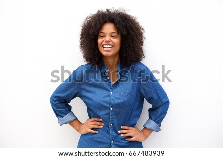 Portrait of friendly woman smiling on isolated white background #667483939