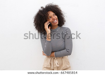 Portrait of happy black woman talking on mobile phone #667485814