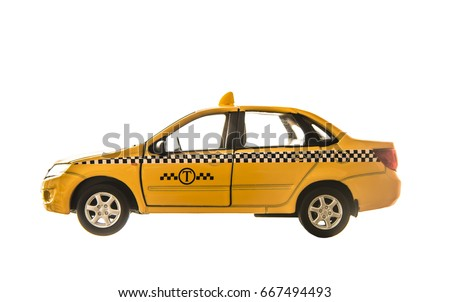 toy - yellow taxi car model. isolated on white background. yellow taxi car. idea, symbol, concept of urban service #667494493