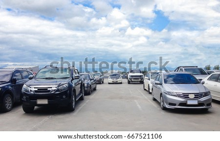 Car parked in parking lot and empty space at the rooftop of car parking building with white cloud and blue sky background #667521106