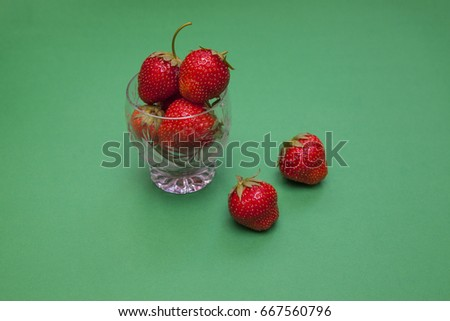 Strawberry on a green background #667560796