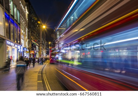 London, UK, October 05 2016: Crowded Oxford street with city bus passing by at night #667560811