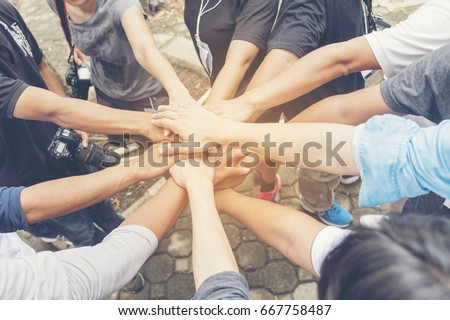 Concept partnership. Group of Photographers  Partners Team with hands together trusted each friends. Hands stacked Holding of business partners.Trust business in authentic of people. #667758487